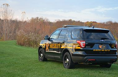 Sheriff vehicle in the Grass